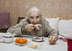 12844809-Old-lady-European-drinking-tea-at-home--Stock-Photo